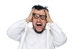 Hombre insano en la camisa de fuerza aislada en blanco Fotografía de archivo libre de regalías