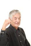 Hombre japonés mayor en una actitud de la victoria Fotografía de archivo
