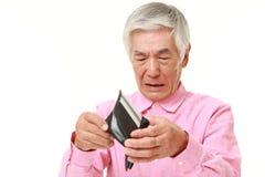 Hombre japonés mayor pobre Foto de archivo libre de regalías