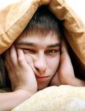 Hombre joven aburrido Fotografía de archivo