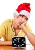 Hombre joven aburrido en Santa Hat Imágenes de archivo libres de regalías