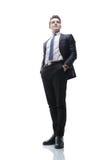 Hombre joven acertado en un traje de negocios Imagen de archivo libre de regalías
