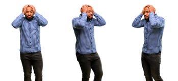 Hombre joven africano aislado sobre el fondo blanco fotos de archivo libres de regalías