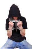 Hombre joven arrestado en esposas Fotos de archivo libres de regalías