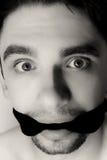 Hombre joven asustado con el vendaje en boca Fotos de archivo