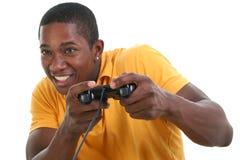 Hombre joven atractivo con la pista del control del juego video Fotografía de archivo libre de regalías