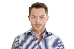 Hombre joven atractivo en camisa azul que mira fijamente la cámara Imagen de archivo