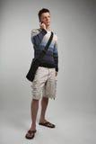 Hombre joven atractivo en el teléfono celular Imagen de archivo libre de regalías