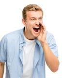 Hombre joven atractivo que grita - aislado en el fondo blanco Foto de archivo libre de regalías