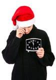 Hombre joven cansado con el reloj Imagen de archivo