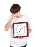 Hombre joven cansado con el reloj grande Fotografía de archivo libre de regalías