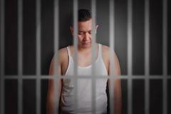 Hombre joven cerrado en cárcel imágenes de archivo libres de regalías