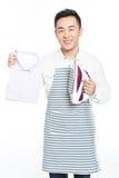 Hombre joven chino que plancha su ropa Foto de archivo libre de regalías