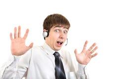 Hombre joven chocado con las auriculares Fotografía de archivo libre de regalías