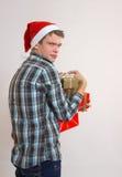 Hombre joven codicioso - Papá Noel Foto de archivo libre de regalías