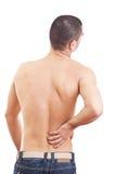 Hombre joven con dolor de espalda imagenes de archivo