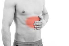 Hombre joven con dolor de estómago Foto de archivo