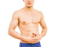 Hombre joven con dolor de estómago Imágenes de archivo libres de regalías
