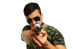 Hombre joven con el arma Imágenes de archivo libres de regalías