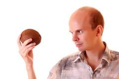 Hombre joven con el coco Foto de archivo libre de regalías
