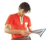 Hombre joven con el cuaderno Fotografía de archivo libre de regalías