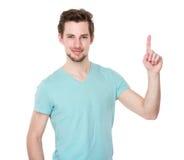 Hombre joven con el destacar del finger Fotografía de archivo