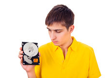 Hombre joven con el disco duro Foto de archivo libre de regalías