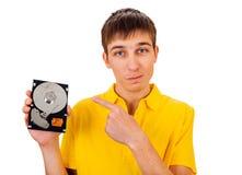 Hombre joven con el disco duro Imagen de archivo