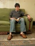Hombre joven con el libro Imágenes de archivo libres de regalías