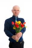 Hombre joven con el manojo de tulipanes Foto de archivo libre de regalías