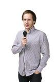 Hombre joven con el micrófono Foto de archivo libre de regalías