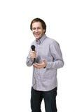 Hombre joven con el micrófono Imagen de archivo