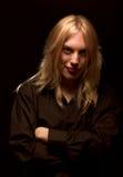 Hombre joven con el pelo rubio largo Imagen de archivo libre de regalías