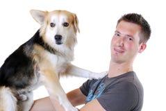 Hombre joven con el perro Fotografía de archivo