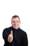 Hombre joven con el pulgar para arriba Imágenes de archivo libres de regalías