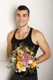 Hombre joven con el ramo de flores Fotos de archivo libres de regalías