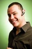 Hombre joven con el receptor de cabeza Fotografía de archivo