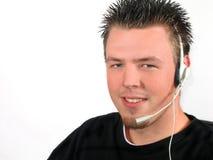 Hombre joven con el receptor de cabeza Foto de archivo libre de regalías