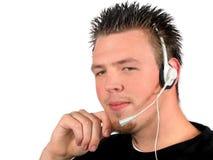 Hombre joven con el receptor de cabeza Imágenes de archivo libres de regalías