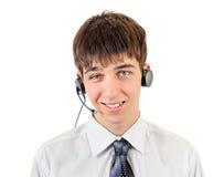 Hombre joven con el receptor de cabeza Imagen de archivo libre de regalías