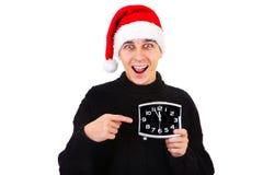 Hombre joven con el reloj Imágenes de archivo libres de regalías