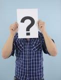 Hombre joven con el signo de interrogación Foto de archivo libre de regalías