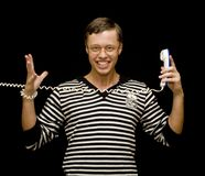 Hombre joven con el teléfono Fotos de archivo libres de regalías