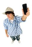 Hombre joven con el teléfono celular Fotografía de archivo libre de regalías