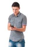 Hombre joven con el teléfono celular Fotos de archivo libres de regalías