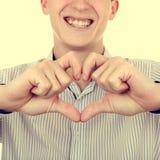 Hombre joven con forma del corazón Fotos de archivo libres de regalías