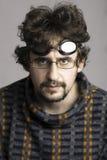 Hombre joven con la barba y los vidrios Foto de archivo libre de regalías