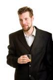 Hombre joven con la bebida Imagen de archivo libre de regalías