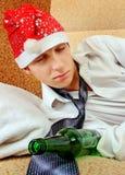 Hombre joven con la botella de la cerveza Fotografía de archivo libre de regalías