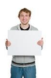 Hombre joven con la cartelera en manos Imagen de archivo